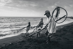 Fishermen Pulling The Net, Boom Beach, Banyuwangi (syukaery) Tags: trip travel sea vacation people blackandwhite bw seascape tourism beach monochrome indonesia landscape scenery fishermen sony shoreline sigma dailylife humaninterest 19mm eastjava jawatimur banyuwangi vsco nex5 vscofilm nex5r