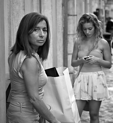 Don't look at my daughter. I was taking a shot of the young lady on the right, when her mother came out of a shop on the left, I just needed a dirty raincoat to compleate the picture!!!!! (Baz 120) Tags: life street city portrait people urban blackandwhite bw italy rome roma monochrome mono italia faces candid strangers streetphotography streetportrait olympus monotone streetphoto unposed 45mm omd decisivemoment candidportrait streetphotographer m43 streetcandid mft streetphotograph primelens em5 candidstreet candidface