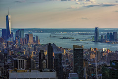 Famous (Мaistora) Tags: ocean plaza city nyc roof urban usa ny newyork seascape tower rooftop monument statue skyline architecture contrast skyscraper buildings river emblem lens observation liberty island islands bay us construction memorial cityscape view symbol zoom crane terrace manhattan sony horizon wide clarity icon panoramic cranes telephoto planning nik wtc rockefeller process metlife iconic postprocess pse edit topoftherock symbolic birdseye distant topaz lightroom birdeye nex riverscape restyle emblematic maistora totr 5r 55210mm yahoo:yourpictures=weather nex5r sel55210oss