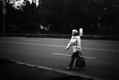 Vega II - Woman Crossing the Street (Kojotisko) Tags: street city people streets vintage person czech streetphotography brno cc creativecommons vintagecamera czechrepublic streetphoto persons vega czechoslovakia druopta fomapan400 fomapan400action druoptar vega2 vegaii druoptar145f50mm