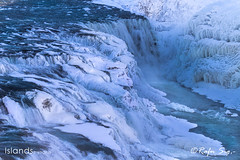 Big powerful waterfall in wintertime