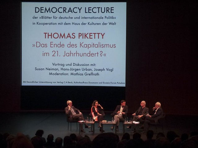 Thomas Piketty (middle) at Haus Der Kulturen Der Welt in Berlin