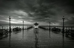 Pier into the Mood (Captain Nikon) Tags: wet rain reflections mono pier moody symmetry dorset southcoast swanage isleofpurbeck swanagepier swanagebay sigma1020mmf4 nikond7000