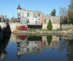 Leland Hotel and Cafe and reflection in the Rock River, Belvidere Illinois, 10-2014 -2 (polepenhollow) Tags: reflections river illinois roadsideamerica touring rockriver belvidere offthebeatenpath
