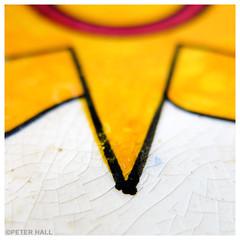 Glazed Sun (peterphotographic) Tags: img7251sqcb2lolowm glazedsun camerabag2 canon g15 square ©peterhall walthamstow e17 eastlondon london england uk britain macro macromondays glaze closeup yellow sun crackle dish bowl dof bokeh depthoffield