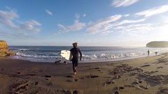 Here I run - Bells Beach Australia (minimi007) Tags: australia bellsbeach blue clouds man outdoors sand sea sports sunset surf surfboard surfer surfing water