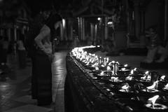 Holy candles (Feca Luca) Tags: street reportage night notturno blackwhite people buddhism buddha buddhist buddismo religion religione myanmar birmania asia nikon perspective