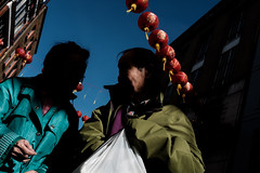 Throwing shade in Chinatown (samrodgers2) Tags: chinatown lanterns red londonstreetphotography london londonlightandshade street photography