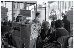 In Chains. (sdupimages) Tags: candid bokeh bar café terrasse newspaper journal lecanard rue street insta bw nb noirblanc blackwhite