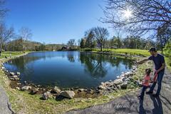 Exploring (jmhutnik) Tags: pond spring water child dad sky trees rocks coonskinpark charleston westvirginia april shadows fisheye