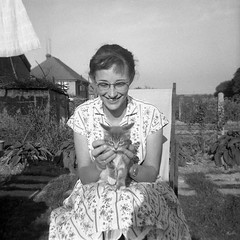 Smiling lady with a kitten (vintage ladies) Tags: vintage vintagelady portrait people photograph portriat blackandwhite female lady woman 50s 50slady 50swoman 50sstyle deckchair cat smile smiling garden eoshe pretty lovely kitten glasses