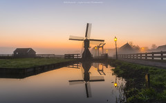 Zaanse Schans - Windmill Village - Nederland (Light Levels Photoworks) Tags: zaanse schans windmill village moulin nederland holland hollande niederland architecture architektur amsterdam landscape landschaft paysage hauser haus dämmerung water wasser nacht kanal beleuchtung blue blaue bridge brücke before d750 dusk dust hdr nebel brouillard wetter perspectives light lights night nightshot nikon licht time nikond750 lichter lzb morning hour photo photography river reflexion stunde spiegelung twillight view travel world wideangle sweet fluss sonnenuntergang europe europa sunlight romantic romantik dorf windmühle