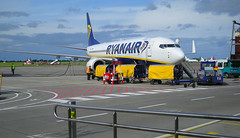 Human Baggage (Owen J Fitzpatrick) Tags: ojf people photography nikon fitzpatrick owen j joe pretty pavement chasing ireland editorial use only ojfitzpatrick eire dublin republic city tamron airport ryanair boeing 737 aero plane aviation flight fly low cost bargain logo airliner airline airside coolpix l12 cockpit yellow uk united kingdom open apron fire point stand 107 markings parked luggage aircraft blue white baggage human push back truck vehicle train od