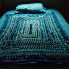 Putting a granny rectangle blanket to bed (crochetbug13) Tags: crochet crocheted crocheting crochetsquare yarnscraps grannysquare grannysquares crochetpurse blues greens crochetblanket crochetafghan granny rectangle