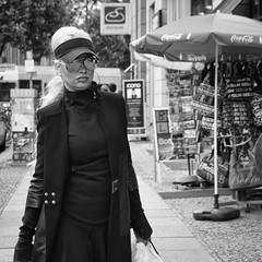 Lady; Mirrored Sunglasses (kohlmann.sascha) Tags: street people blackandwhite bw woman sun house building berlin blancoynegro sol monochrome sunglasses weather hair advertising deutschland glasses noiretblanc candid streetphotography streetportrait haus menschen sunshade advertisement blond parasol monochrom brille frau eyeglasses werbung schwarzweiss sonne gebäude geschäft sonnenbrille biancoenero wetter haare mensch haar candidportrait sonnenschutz beachumbrella sonnenschirm auslage commercialbuilding schwarzweis geschäftshaus protectioncontrelesoleil ladenlokal streetfotografie protecciónsolar strasenfotografie protezionecontroilsole