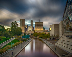 Indianapolis Skyline (Dr_Fu_Manchu) Tags: city reflection clock skyline museum clouds america skyscraper canal memorial long exposure cityscape state cloudy walk indianapolis capital bank indiana steam capitol indianastatemuseum congressionalmedalofhonor nikond7000