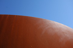 "Richard Serra's ""Sequence"" - detail (KevinIrvineChi) Tags: sanfrancisco blue light shadow sky sculpture orange sun art texture museum rust san francisco university shadows steel sony sfmoma rusty sunny 2006 curvy surface edge stanford rough curve sequence textured richardserra orangeblue cantorartscenter dscrx100 27ccfbt"