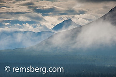 Alaskan mountain range obscured by afternoon haze (Remsberg Photos) Tags: wild sky usa mountains ice nature horizontal alaska clouds landscape death dangerous solitude day earth colorphotography scenic peak nopeople palmer hidden covered remote strength concept hiding awe majestic discovery idyllic challenge struggle alaskarange digitalimage determination intimidating skill removed aspirations abovetheclouds mountainrange accessibility snowcap naturalphenomenon inthedistance coldtemperature inreach eclpised lastfrontiere