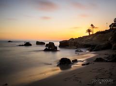 Laguna Sunset (dougsooley) Tags: longexposure sunset sea sky orange sun seascape clouds canon landscape landscapes seaside sunsets laguna seashore lagunabeach longexposures canonlenses canonlens canon1dx