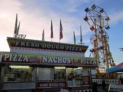 Fresh Dough Pizza/NachosTrailer And Big Rock Amusements Sky Wheel. (dccradio) Tags: carnival sky fun nc northcarolina fair entertainment midway countyfair amusements lumberton carnivalrides amusementrides skywheel communityevent thrillrides fairrides doubleferriswheel mechanicalrides robesoncountyfair bigrockamusements robesonregionalagriculturalfair