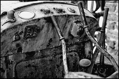 Rusty Cockpit (Italian Film Photography) Tags: bw abandoned monochrome rust decay cockpit gear bn motors cambio leve dust vanishing lever ruggine trattore comando abbandono agricolo
