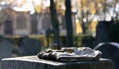 Gravediggers loss? (Hulalena) Tags: autumn light fall cemetary herbst statues graves glove grab freiburg statuen handschuh hauptfriedhof instameet instameetup
