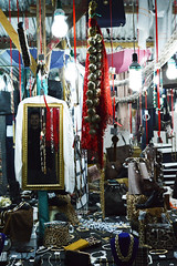 Happy Market Ghost (Elisabeth Arvaniti) Tags: greece larissa thessaly bazaar market mirror face smile funny bizou table scarfs earrings bracelet leopar shoes necklace cheap garlic luck fortune gipsy lights blue red colours