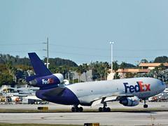 FedEx Express McDonnell Douglas DC-10-10F Landing at the Miami International Airport (Comiccreator24) Tags: mia kmia miamidade miamidadecounty miamiinternationalairport aviation avgeek mcdonnelldouglas dc10 dc10f mcdonnelldouglasdc10 trijet triholder fedex federalexpress fedexexpress