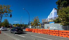 Work has Started on the Old Church (Jocey K) Tags: newzealand southisland christchurch architecture buildings street road sky earthquakedamagedbuilding cars trees shippingcontainer roadbarriers tree cbd