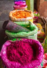 'Colour' (@jo_did_this) Tags: colour holi dye multicoloured bag sack pigment paint cerise pink green orange bright vivid market linedup festival hindu traditional celebration powder