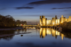 Cyfnos ger Castell Caernarfon / Dusk at Caernarfon Castle (Ffotograffiaeth Dylan Arnold Photography) Tags: caernarfon castle reflection water quay bridge historic cadw unescoworldheritagesite cymru wales cofi night lowlight lights longexposure canon70200mmf28lisusmii canoneos6d clouds boats dusk tranquil serene outdoors bluehour slatequay bontaber walledtown kingedward longshanks calm quiet