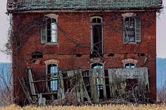 Along Highway 79, Missouri (RonniShae) Tags: abandoned forgotten missouri photography ivy old nature overgrown building boardedup fallingapart field wood sky windows