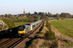68012 - Kings Sutton (Andrew Edkins) Tags: 68012 class68 cat railwayphotography churchspire chilternrailways passengerservice northamptonshire england uk travel trip commuter vossloh sun trees field carriages evening geotagged 1g49 banbury light