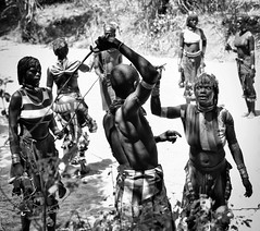 The Whipping, Hamar Tribe (Rod Waddington) Tags: africa african afrika afrique äthiopien ethiopia ethiopian ethnic ethiopie etiopia omo omovalley hamar hamer tribe traditional tribal whipping whip bullah ceremony bull jumping blackandwhite candid woman warrior group people outdoor creek