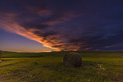 All Alone Under A Prairie Sunset (J Swanstrom (Check out my albums)) Tags: sunset evening sky clouds color vibrant vivid hay bale prairie field horizon nikon d750 jswanstromphotography pickerellake dynamic peaceful relaxing hill