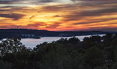 Firey Sunset Over the Ozarks (SteveFrazierPhotography.com) Tags: sunset clouds glow lake lakeozark lakeoftheozarks ozarks camdencounty missouri mo landscape scene scenery water evening fall october2016 stevefrazierphotgraphy orange red yellow blue silhouette beautiful stevefrazierphotography autofocus