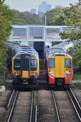 Passing (South West) Trains... (stavioni) Tags: blue west electric train south north siemens railway trains richmond multiple emu alstom sheen juniper unit swt desiro class450 8024 class458 450090 458025
