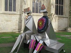 Guerilla crochet! (pefkosmad) Tags: street city urban sculpture art wool public knitting funny exterior cathedral crochet exhibition gloucestershire yarn gloucestercathedral lynnchadwick guerillaknitting crucible2 yarnbombing sittingcoupleonabench naughtyknitter