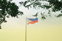 Perlas Ng Silangan (gnivmcelada) Tags: trees photography flag philippines streetphotography manila flagpole philippineflag rizalpark lunetapark skwwpw