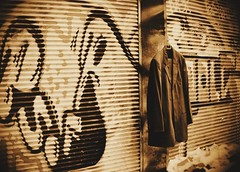 graffity and  aged jacket  (  the crisis still exists) (mare_maris) Tags: poverty street windows urban streetart metal sepia photoshop store costume europe closed forsale market details streetphotography streetscene graffity peoples explore textures greece shutters hanging aged graffito stores crisis longing streetmarket downed shuttered allimages dayshot urbanshots graffitie ελλαδα streetartproject seenin upforsale menscostume πειραιασ windowsclosed nikond5100 maremaris agedjacket walkinginthemarket peopleslonging downedshutters pireausmarket hangingforsale thecrisisstillexists