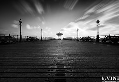 Swanage Pier (byVini photography) Tags: wood uk sea blackandwhite cloud reflection beach nature wet horizontal architecture outdoors photography pier cloudy nopeople deck boardwalk railings swanage absence tranquilscene dorsetuk builtstructure viniciosdemoura byviniphotographycom
