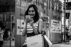 Joyful message | Bangkok 2016 (Johnragai-Moment Catcher) Tags: people photography portrait candidportrait bangkokstreet bangkok blackandwhite blackwhite johnragai johnragaiphotos johnragaistreet johnragaibw street streetphotography decisivemoment gesture expression