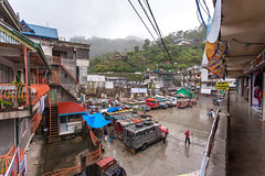 Banaue in the Rain _8107 (hkoons) Tags: maritimesoutheastasia southeastasia citystreets riceterraces banaue city cordilleras ifugao luzon philippines rice buildings bus crowded island islands jeep jeepney mountains public road roads street transportation tropical tropics