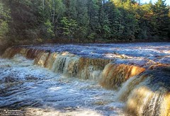Tannic Water of Lower Falls in Dappled Sunlight at Tahquamenon Falls (PhotosToArtByMike) Tags: tahquamenonfalls lowerfalls michigan tahquamenonfallsstatepark mi tahquamenonriver upperpeninsulaofmichigan upperpeninsula up uppermichigan waterfall river tanninswater tannic cedarswamps forested forest newberrymichigan autumn autumnleaves