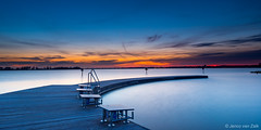Waiting for the sun (© Jenco van Zalk) Tags: leefilters lee landscape polariser grad jetty swimming startingblocks zeewolde netherlands nature sun sunlight waiting colors sunrise blue orange longexposure lake lakewolderwijd panorama sky outdoors nopeople clouds water bluehour dawn