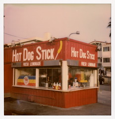 Hot Dog Stick (tobysx70) Tags: the impossible project tip polaroid sx70sonar sonar instant color film for sx70 type cameras impossaroid hot dog stick ocean front walk santa monica california ca sign red hotdogonastick original og corndog ketchup mustard lemons fresh lemonade stand restaurant security camera 031017 cromwalk polawalk toby hancock photography