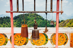 Buddhist bells at Tiger Cave Temple (Evgeny Ermakov) Tags: asia asian buddha krabi southeast southeastasia thailand tigercave tigercavetemple bell bells buddhism buddhist buddhistic clouds culture exotic forest heritage mountain mountains nature orange rainforest religion religious sky temple touristic travel tropical vibrant view