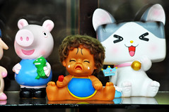 Not so happy to be there (Roving I) Tags: crying tears babies unhappy smiles pigs dragons cats toys homedecor bookstores shops retail danang vietnam fahasa