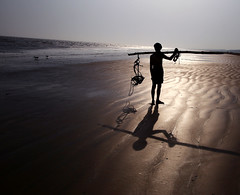 Sillhouette- home return, Chandipur,Odissa, India (senguptapulak) Tags: beach reflection silhouette fisher man shadow dusk golden chandipur odissa india canon 6d autofocus