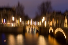 The Blurry Amsterdam (Ntino Photography) Tags: amsterdam netherlands holland bridges nightphotography longexposure blur sky sunset bluehour canoneos5dmarkiii canon35mmf2 canals outdoor spring lights citylights abstract